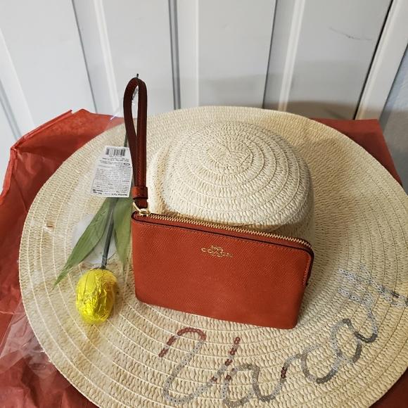 Coach Handbags - Coach wallet and a hat a rose